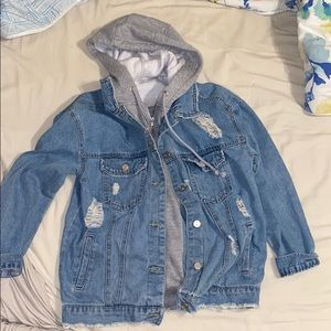 REFUGE - Jean jacket with gray hoodie attached.
